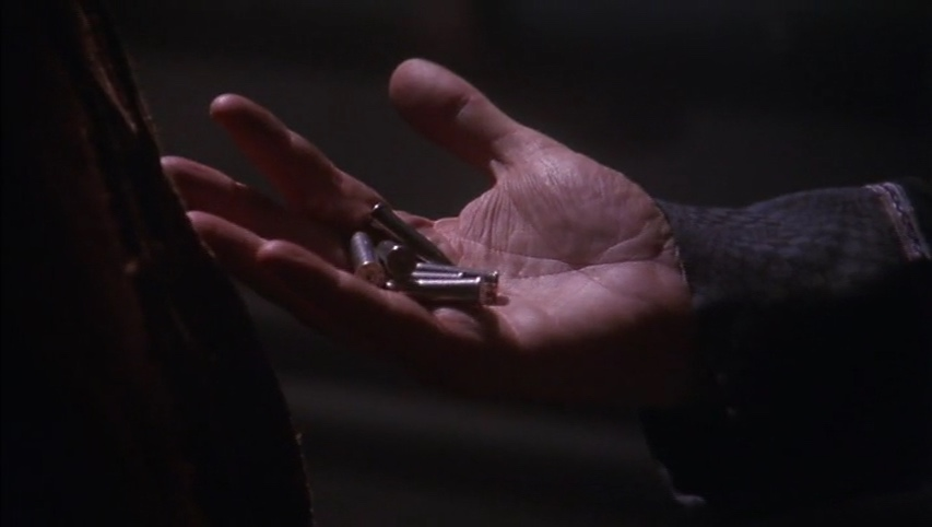 Garibaldi's hand, holding his grandmother's conveniently pocketed antique bullets.