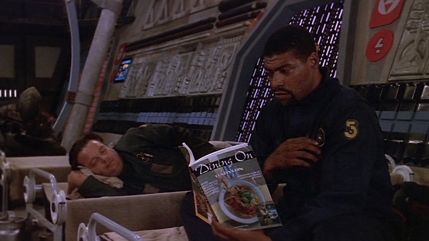 Mack and Bo kill time in a shelter during an attack on Babylon 5.
