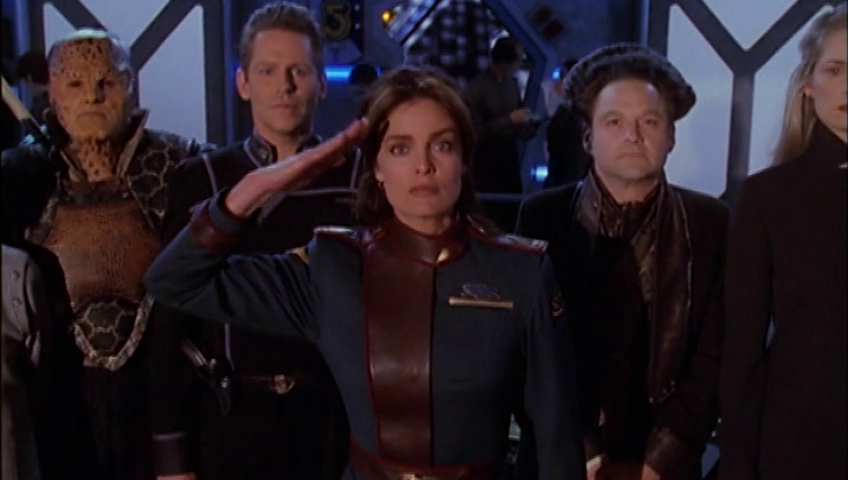 """Lochley and the """"replacements"""" for all of our historic characters (save Delenn) stand in C&C, Lochley saluting."""